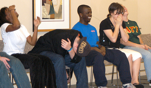 college-hypnotist-laughing-students